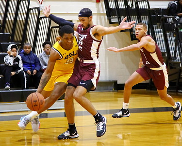 George P. Smith/The Montgomery Sentinel    Bowie State's Kani Coles (23) turns the corner on Fairmont State's Kenzie Melko-Marshall (31).