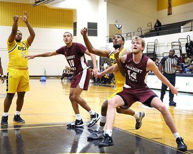 George P. Smith/The Montgomery Sentinel    Bowie State's Cameron Hayes (22) and Fairmont State's Jacob Brown (14) battle under the boards for a rebound.