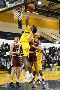 George P. Smith/The Montgomery Sentinel    Bowie State's Saiquan Jamison (21) with the put back over Fairmont State's Isaiah Sanders (10).