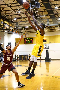 George P. Smith/The Montgomery Sentinel    Bowie State's David Belle (11) with the fade away jumper over Fairmont State's Kenzie Melko-Marshall (31).