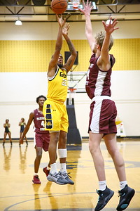 George P. Smith/The Montgomery Sentinel    Bowie State's Cameron Hayes (22) shooting over Fairmont State's Jacob Brown (14).