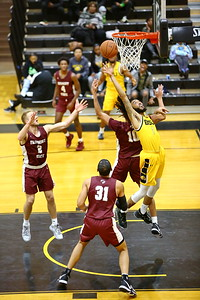 George P. Smith/The Montgomery Sentinel    Bowie State's Justin Route (1) with a put back after rebounding the ball.