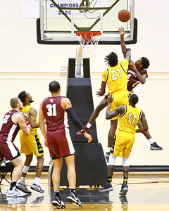 George P. Smith/The Montgomery Sentinel    Bowie State's Saiquan Jamison (21) fouls  Fairmont State's Dale Bonner (4).