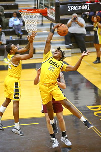 George P. Smith/The Montgomery Sentinel    Bowie State's Saiquan Jamison (21) snags a rebound.