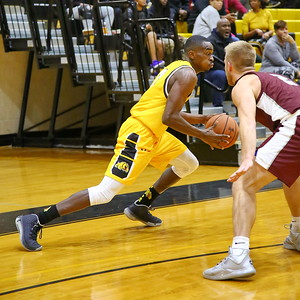 George P. Smith/The Montgomery Sentinel    Bowie State's David Belle (11) drives past Fairmont State's Cole VonHandorf (2).