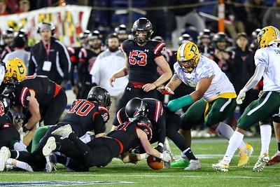 George P. Smith/The Montgomery Sentinel    Linganore's Ryan Barthlow (11) recovers the fumble by Damascus' Chris Shaw (26) as Damascus' Brian Bresee (55), with his broken hand wrapped,  looks large overhead waiting to pounce.