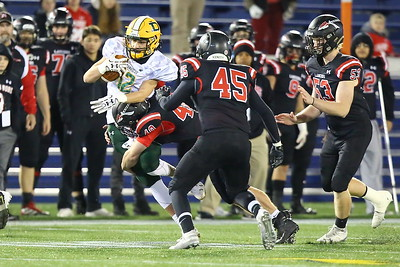 George P. Smith/The Montgomery Sentinel    Linganore's Nick Vance (40) wraps up Damascus' Diego Mendez (12) after a nice gain.