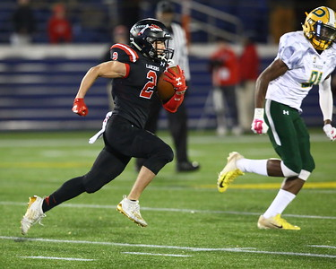 George P. Smith/The Montgomery Sentinel    Linganore's Xander McClure (2), try as he might, was not successful in putting any points on the scoreboard against Damascus in the 38-0 loss to the Hornets on the 2019 State Class 3A Championship game.