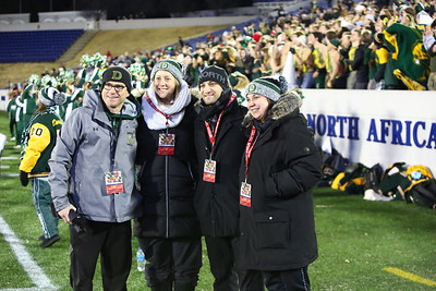George P. Smith/The Montgomery Sentinel    Damascus principal Kevin Yates (left) and members of the Damascus High School administrative team at the State Class 3A Football Championship.
