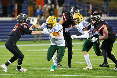 George P. Smith/The Montgomery Sentinel    Damascus' Cole Leslie (7) channeled the Redskins' Darius Guise as he stiff-arms Linganore's Will Coletti (10) to gain additional yards.