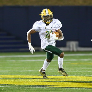 George P. Smith/The Montgomery Sentinel    Damascus' Austin Ambush (21) carries the ball for the Hornets.