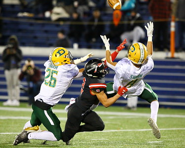 George P. Smith/The Montgomery Sentinel    Even as Linganore's Jihan Samayoa (2) is dragging him to the ground by his jersey, Damascus'  Isiah Bell (11) is able to keep his eye on the ball and maintain his concentration to make this acrobatic catch.