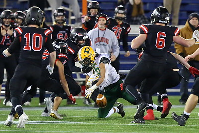 George P. Smith/The Montgomery Sentinel    Linganore's Adam Everett (45) strips Damascus' Chris Shaw (26) of the ball after a nice run.