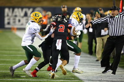 George P. Smith/The Montgomery Sentinel    The ref beats feet as Linganore rides Damascus' Preston Murray (4) out of bounds.