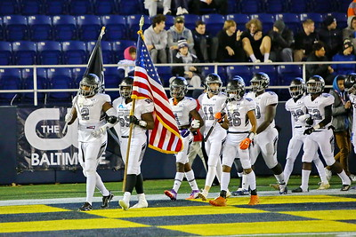 George P. Smith/The Montgomery Sentinel    Northwest takes the field at Navy-Marine Corps Memorial Stadium at the start of the State 4A Championship football game agaisnt Wise - brothers all arm-in-arm.
