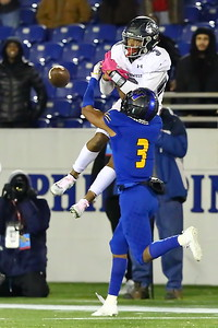George P. Smith/The Montgomery Sentinel    As the ball reaches Northwest's Kaden Prather (3), Wise's Jalil Farooq (3) comes up to break up the catch.