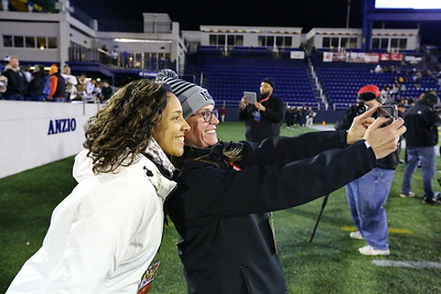 George P. Smith/The Montgomery Sentinel    Northwest Athletic director Anne Rossiter (in grey cap) takes a selfie with a staff member and the Northwest student section in the background.