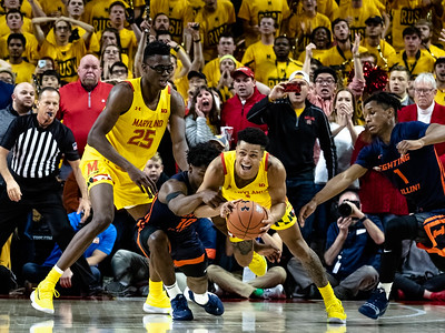 December 7, 2019 - Maryland's Anthony Cowan, Jr. gets one of his three steals and is then fouled by Illinois to stop a break-away attempt. Photo by Mike Clark/The Montgomery Sentinel