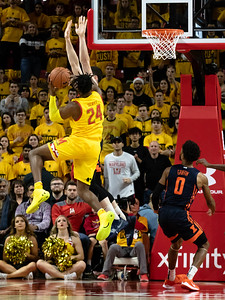 """December 7, 2019 - Maryland's Donta Scott runs into the raised arms of 6' 9"""" Giorgi Bezhanishvili of Illinois. The Ilini height proved a big challenge for the Terps, who fell behind by as much as14 points. Photo by Mike Clark/The Montgomery Sentinel"""