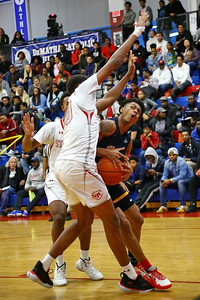 George P. Smith/The Montgomery Sentinel    Bullis School's Rodney Rice (4) pump fakes before going back up against St. John's James Wood (20) and Terrell Webster (1).
