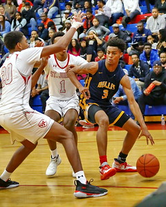 George P. Smith/The Montgomery Sentinel    Bullis School's Rodney Rice (4) pump fakes before going back up.