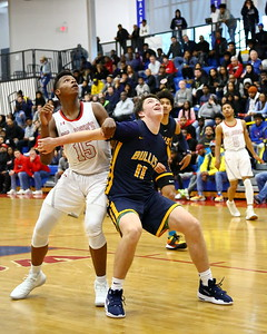 George P. Smith/The Montgomery Sentinel    Bullis School's William Moreau (11) boxing out St. John's Amani Hasberry (15).