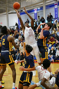 George P. Smith/The Montgomery Sentinel    mid a jumble of fallen players, St. John's Amani Hasberry (15) puts up a rebound.