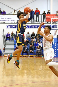 George P. Smith/The Montgomery Sentinel    Bullis' Rodney Rice (4) shoots over St. John's Ishmael Leggett (5) from well beyond the arc.