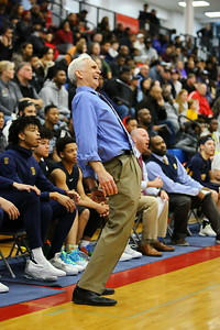 George P. Smith/The Montgomery Sentinel    Bullis' Bruce Kelley tries to help a  shot find the hoop with a little body English.