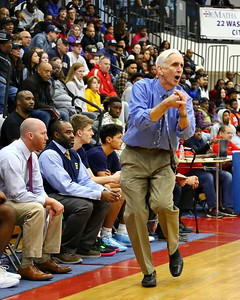 George P. Smith/The Montgomery Sentinel    Bullis School's head coach Bruce Kelley pounds his fist into his hand trying to get a call from a referee during the game against St. John's played at DeMatha.