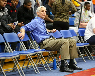 George P. Smith/The Montgomery Sentinel    Bullis head coach Bruce Kelley chills as his team warms up before the game against St. John's.