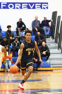 George P. Smith/The Montgomery Sentinel    Bullis' Erik Reynolds starts the transition down court with mere second left in the 3rd quarter.