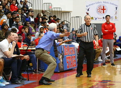 George P. Smith/The Montgomery Sentinel    Bullis School's head coach Bruce Kelley appeals a no call to a second referee.