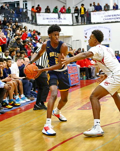 George P. Smith/The Montgomery Sentinel    Bullis' Malcolm Alexander (2) works the ball in from beyond the arc past St. John's Shane Lancaster (1).