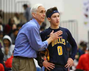 George P. Smith/The Montgomery Sentinel    Bullis' head coach Bruce Kelley with a tip for his guard Cole Hanin (0) during a free throw.