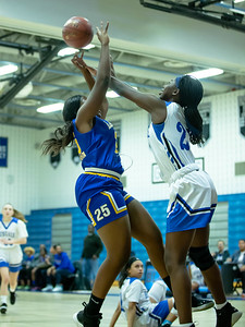 December 13, 2019 - Blake's Rachel Mutumbo blocks Laurel's Franxine Cooper shot in the inter-county game at Hubert Blake High School on December 13, 2019. Photo by Mike Clark/The Montgomery Sentinel