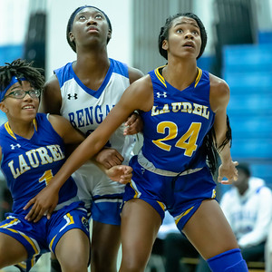 December 13, 2019 - Laurel's Marissa Steel and Nyla Thomas box out Blake's Rachel Mutumbo. Laurel forced missed shots and Bengal turnovers in the second half and cruised to a 48-35 inter-county win at Blake High School on December 13. Photo by Mike Clark/The Montgomery Sentinel