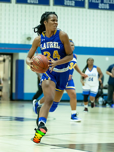 December 13, 2019 - Marissa Steel of Laurel leads the breakaway against Blake in the 48-35 Laurel win at Blake High School in Silver Spring on December 13. Photo by Mike Clark/The Montgomery Sentinel