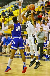 George P. Smith/The Montgomery Sentinel    Richard Montgomery's Will Davenport (34) shoots over Sherwood's Nate Lacey (20).