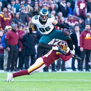 December 15, 2019 - The Eagles' Zach Ertz leaps over a diving Danny Johnson of the Redskins in route to a 27-yard catch and run. Washington came close to tying the game but a turnover and Eagles return for a touchdown came with only 6 seconds left in the game. Photo by Mike Clark/The Montgomery Sentinel