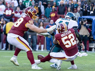 December 15, 2019 - The Redskins Ryan Anderson (52) has an outstanding game with four tackles, two sacks, and three forced fumbles, including this sack and fumble on Carson Wentz.  Photo by Mike Clark/The Montgomery Sentinel