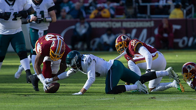 December 15, 2019 - Philadelphia Quaterback Carson Wentz was sacked at on their 33 yard line and fumbled. The Eagles JJ Arcega-Whiteside battles for the lose ball, which was recovered by  Washington's Jonathan Allen. Photo by Mike Clark/The Montgomery Sentinel
