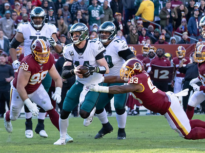 December 15, 2019 - Jonathan Allen of the Redskins tracks down Philadephia Quarterback Carson Wentz for one of his seven tackles in the 37-27 loss to the Eagles at FedEx field on December 15. Photo by Mike Clark/The Montgomery Sentinel