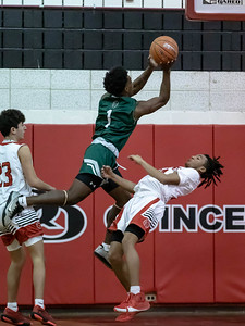 December 19, 2019 - Quince Orchard played smart defense on plays like this where Amir Gray draws the charge on Tuscarora's Brandon Evans. Host QO would dominate the second half of this inter-county game and won 59-36. Photo by Mike Clark/The Montgomery Sentinel