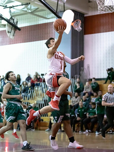 December 19, 2019 - Alex Parisotto of Quince Orchard leads this fast break against Tuscarora. Parisotto led all scorers with 15 points in the 59-36 QO win. Photo by Mike Clark/The Montgomery Sentinel