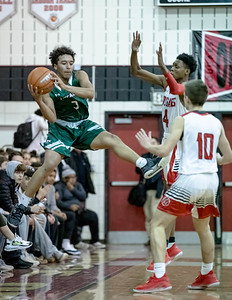 December 19. 2019 - Quince Orchard's smothering defense forced Tuscarora into multiple turnovers and forced shots in their 59-36 loss to host QO Cougars. Photo by Mike Clark/The Montgomery Sentinel
