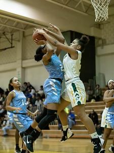December 20, 2019 - Seneca Valley's Briana Dorsey gets the block on Clarksburg's Anaya Martin in the 93-47 win at Seneca Valley. Photo by Mike Clark/The Montgomery Sentinel