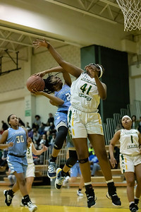 December 20, 2019 - Clarksburg's Mia Smith avoids the block attempt by Seneca Valley's Briana Dorsey to two of her six second-half points in the 93-47 win at Seneca Valley. Photo by Mike Clark/The Montgomery Sentinel