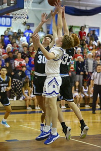 George P. Smith/The Montgomery Sentinel    Sherwood's Matt Nazzaro (32) battles Whitman's Michael Bass (30) and Spencer Caverly (33) for a rebound under the boards.
