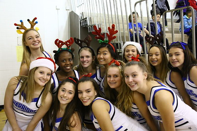George P. Smith/The Montgomery Sentinel    The Sherwood cheerleaders were in a festive mood during the game against Walt Whitman just before the holiday break.